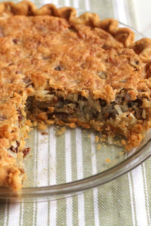 A must-try state fair pie with creamy coconut, vanilla and pecans!