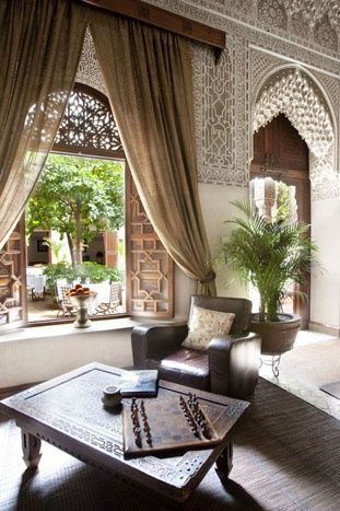 Shutters at DR window? Moroccan living room overlooking a gorgeous courtyard. Somewhere in Morocco. #Moroccan #Courtyard #Riad.