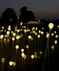 Place LED lights in the balloons and string them at alternating lengths to give a layered look.