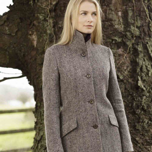 A beautiful Donegal #tweed coat. The rich purple and camel fabric is a soft cashmere and lambswool mix, designed and woven in our mill in #Donegal.