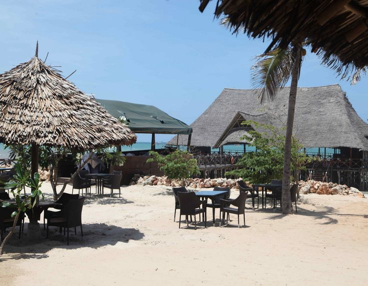 A warm welcome to our spectacular Giraffe Ocean View Hotel. This magnificent ocean view hotel offers a tranquil environment a complete escape from the city noise to its habitat. #beautiful #beachfront #familyfun #holiday #pool #travel #tanzania  http://thebeachfrontclub.com/beach-hotel/africa/united-republic-of-tanzania/dar-es-salaam/dar-es-salaam-beach/giraffe-ocean-view-hotel/