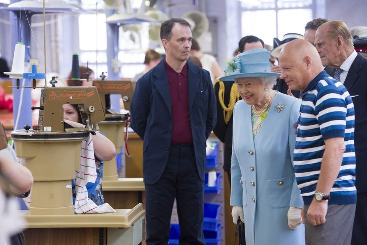 The Queen is shown round John Smedley's knitwear factory.