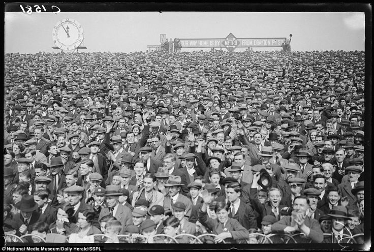 Packed terrace: The crowd at Arsenal v Sheffield Wednesday on April 14, 1933, in this photograph taken by George Woodbine