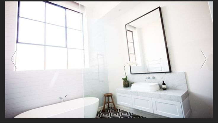 White bathroom with white Vj paneling and feature tile floor