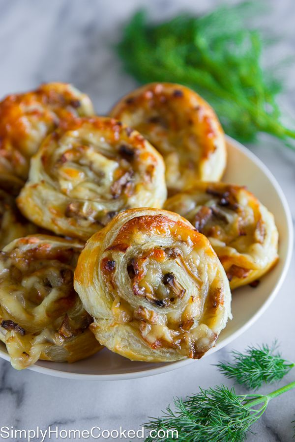 These cheesy mushroom pinwheels are the perfect appetizer for a holiday potluck. They can be eaten warm or at room temperature. I love serving these as an appetizer because they can easily be made hours in advance. Anyone who enjoys the combination or garlic, mushrooms, and cheese will definitely love these pinwheels!