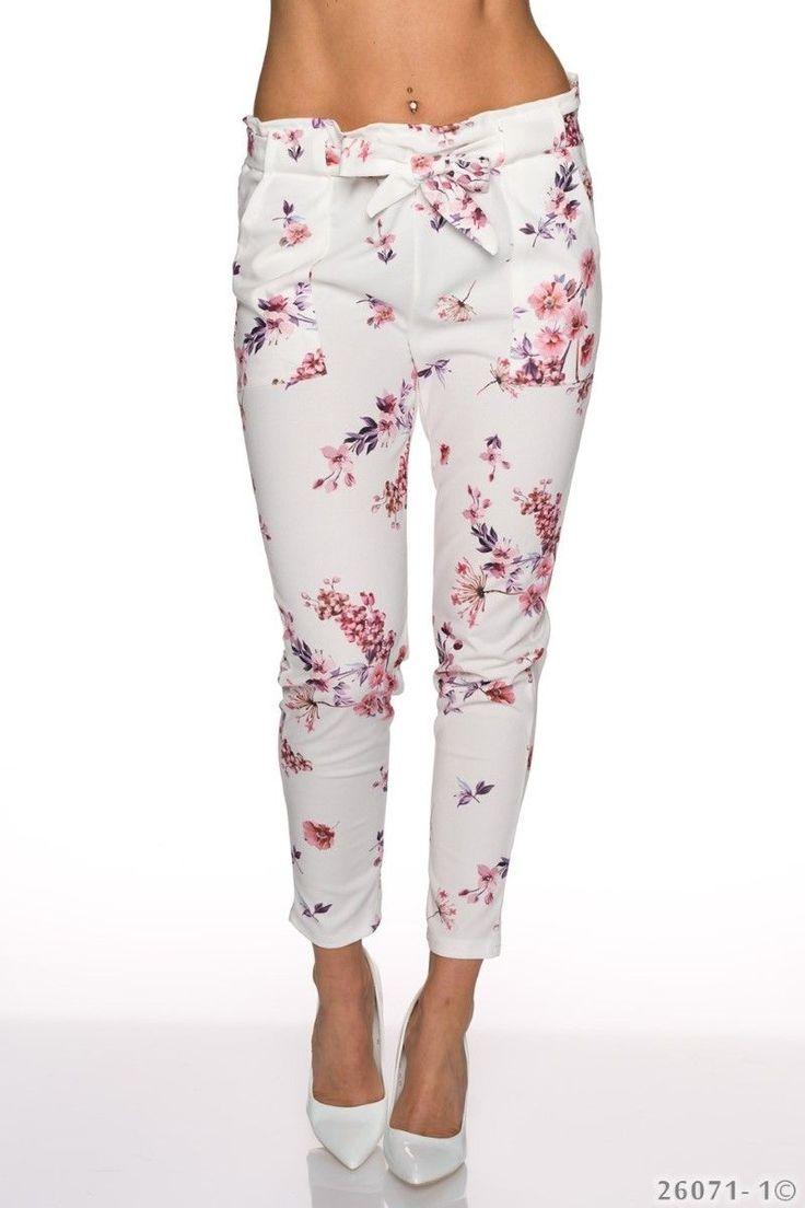 Φλοράλ παντελόνι με ζώνη και τσέπες.95% Polyester 5% Elastane