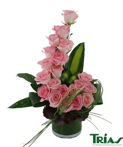 In this twist on the traditional pink rose bouquet, we bring you the Pink Rose Wave! 20 of our exquisite long stem pink roses, masangena and galax leaves, is what makes this elegant and dazzling bouquet a Trias fan favorite!