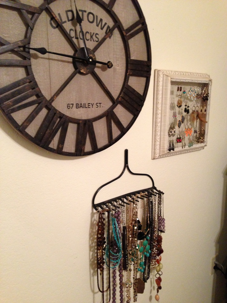 Clock from hobby lobby, spray painted metal rake for Home Depot, & picture frame from goodwill plus chicken wire. Turn your jewelry holders into a decorative wall collage! voila!