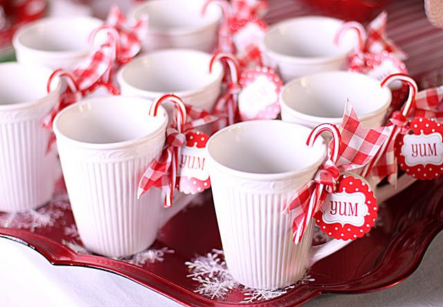 You had said something about a hot cocoa bar? Not sure if you still want to, but you could use candy canes with pink ribbon