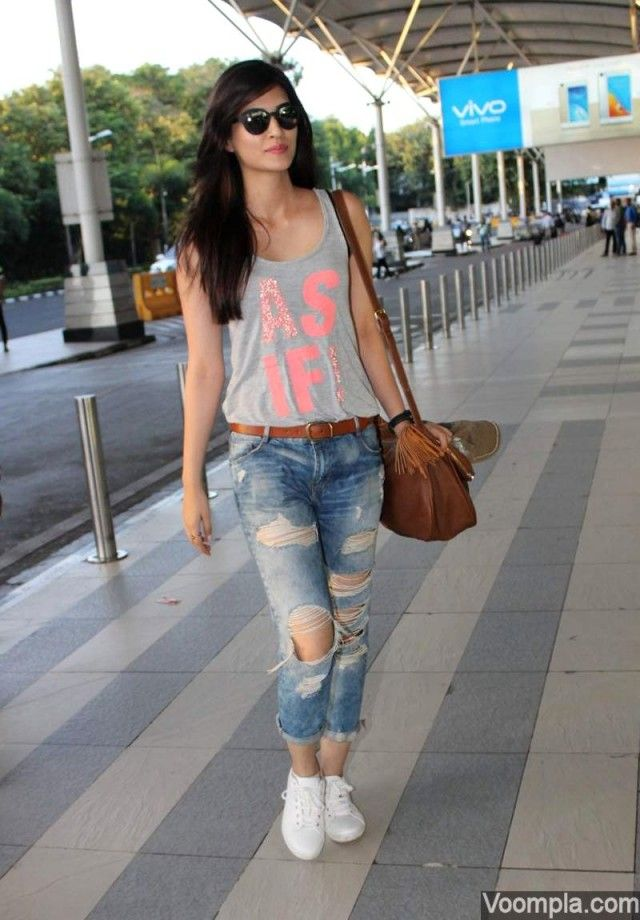Kriti Sanon flaunts her street style in a tank top and ripped jeans at Mumbai airport. via Voompla.com