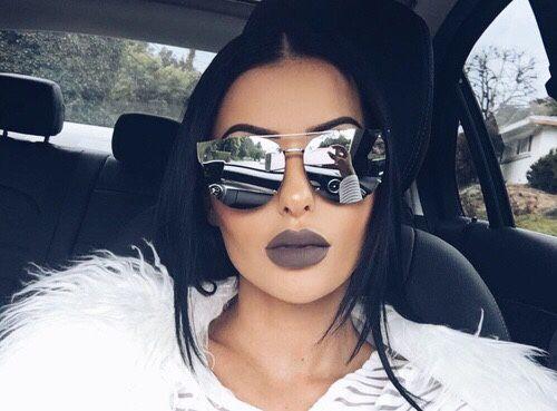 Dark grey lips.