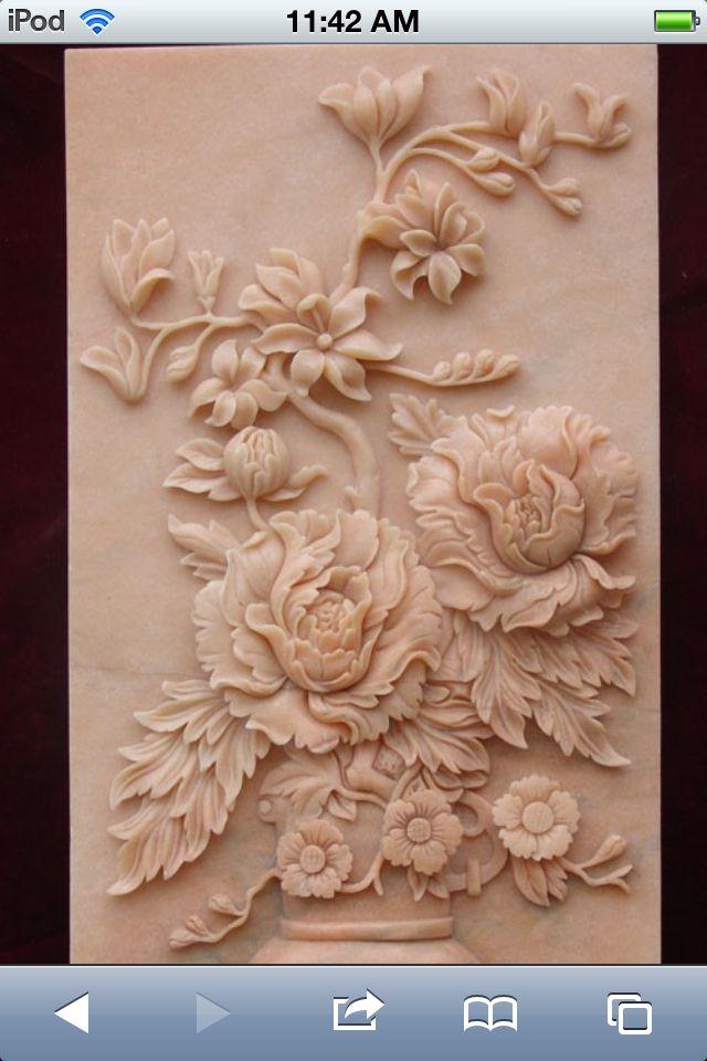 Flower relief sculpture