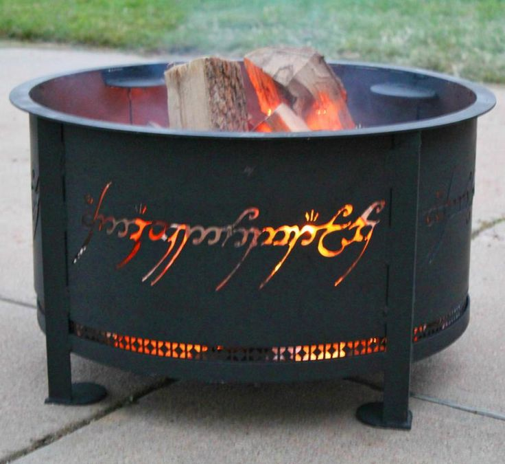This fire pit is made to look like the One Ring from Lord Of The Rings in that it has inscribed text on the side of the panel that is only readable when the flame inside the fire pit is lit, just like...