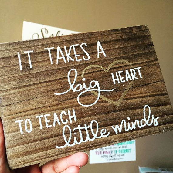 This is a 5x7 stained wood block with the phrase It takes a big heart to teach little minds. Includes a gold accent heart.
