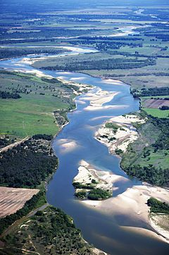 Red River, Oklahoma, Texas, Arkansas & Louisiana - 1.125 miles. Flows into Atchafalaya and Mississippi rivers.
