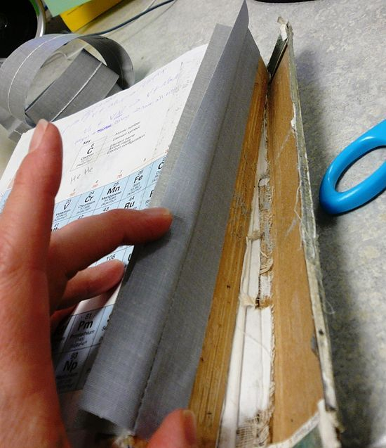how to fix think book torn apart from cover