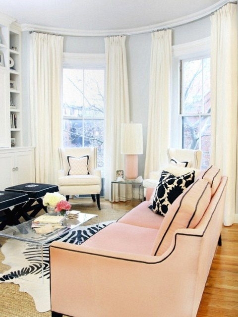 Pink sofa with black piping