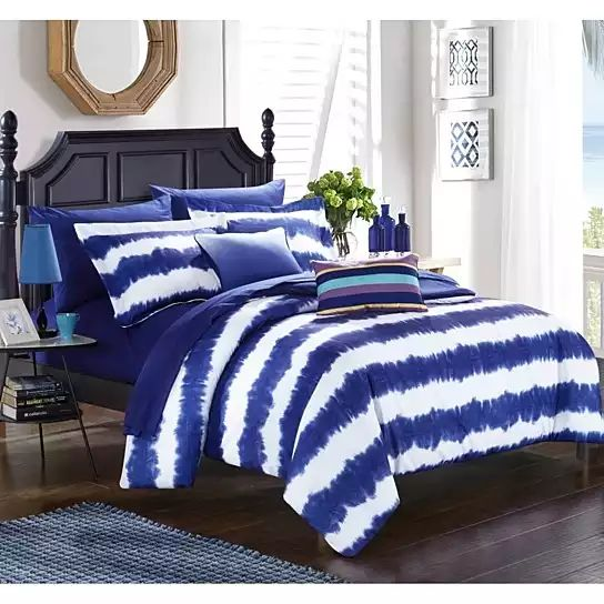 ''This hand dip-dyed comforter set brings bright color and beach surf inspired style to your room. The fabric is hand dipped to create a bright sun inspired look, Colorful tie-dye decorative pillows and coordinating sheets are sure to complete the look.9 Piece Full Set Includes: One (1) Comforter, Two (2) Shams, One (1) Fitted Sheet, One (1) Flat Sheet, Two (2) Pillow Cases, One (1) Dec Pillow, One (1) Dec Pillow7 Piece Twin X-Long Set includes: One (1) Comforter, One (1) Sh...