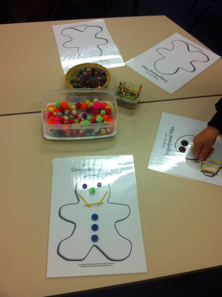 Designing your own Gingerbread Man. We used coloured pom-poms, matchsticks and coloured buttons.