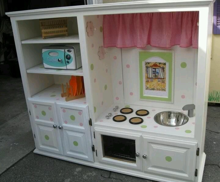 A Childs Pretend Kitchen Made From An Old Entertainment Unit
