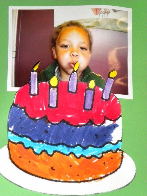 foto blazende kleuter en taart met kaarsjes