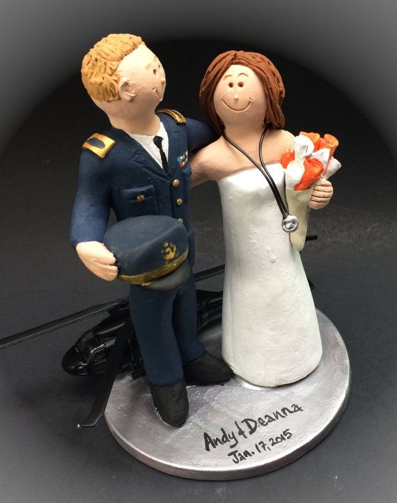 Dress Blues Military Uniform Wedding Cake Topper, Blackhawk Helicopter Pilot Wedding Cake Topper, Air Force Pilot's Wedding Cake Topper    This photographed listing is but an example of what we will create for you....simply email or call toll free with your own info and pictures of yourselves, and we will sculpt for you a treasured memory from your wedding!    $235   #magicmud   1 800 231 9814   www.magicmud.com