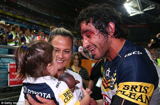 Thurston of the Cowboys celebrates victory with his wife Samantha Lynch and daughter Frankie