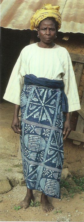 "Woman wearing stencilled starch resist adire wrapper, Ila-Orangun, Nigeria, 1974. Photo by John Pemberton 111 from Abiodun, Pemberton and Beier, ""Cloth Only Wears to Shreds"" (2004)"