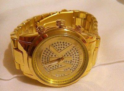 Reloj mujer mk color oro marcado con letrras michael kors