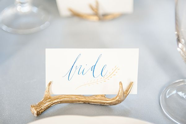 Gold dipped antler place holder with custom calligraphy name card. See more at Rebecca Chan Weddings and Events http://www.rebeccachan.ca