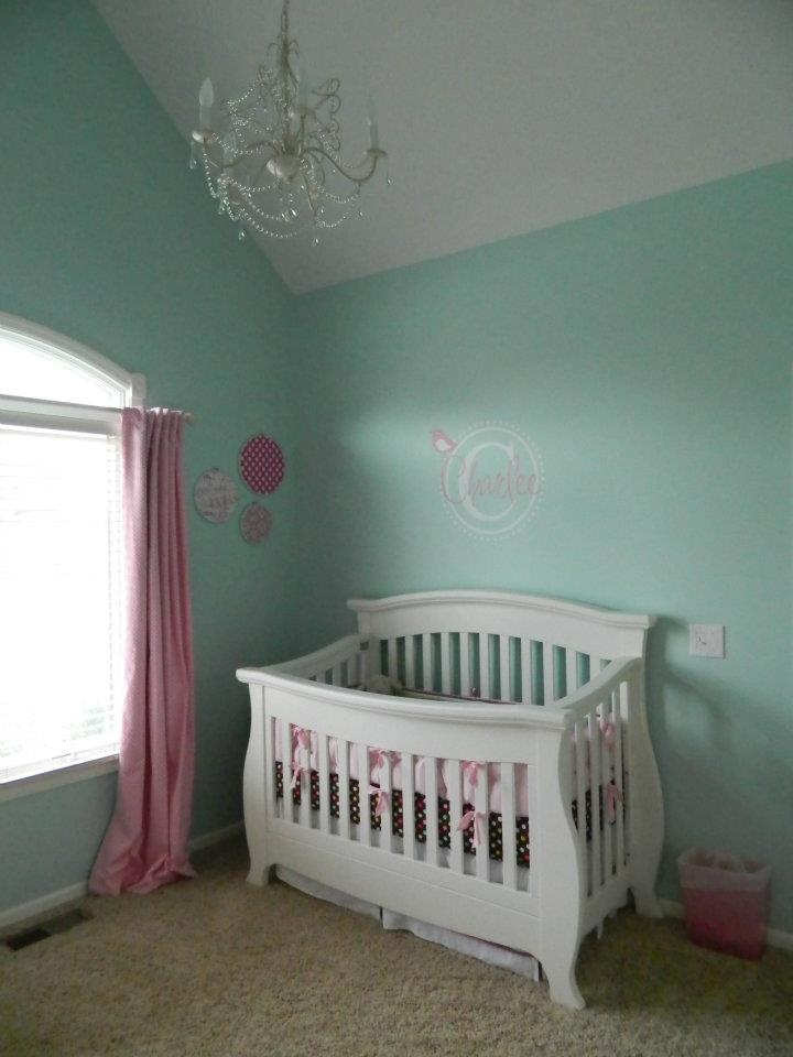 The aqua and pink with black accents really make this white crib pop.  Renassaince Crib
