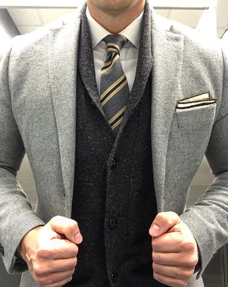 Striped skinny tie layered with grays.