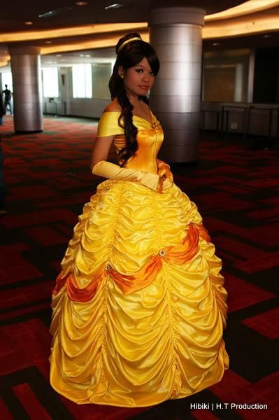 DIY Princess - Belle's Dress DIY.  I love how intricate it looks!  I didn't read the tutorial, don't even know if there is one, but I imagine you could just thread through each fold in the skirt, secure each one, and pull them up for those fancy loops!