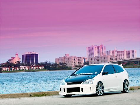 Supercharged 2002 Honda Civic Si.  this is actually so sick.  i love honda civics for some reason.