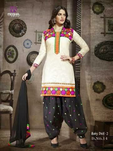 Beautifully Designed White Patiyala Dress in Cotton with awesome embroidery work done. Comes along with Black contrast matching finely embroidered Bottom and Duppatta.