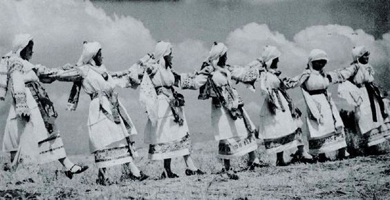 """Chios, Kalamoti Bridal costumes Dancing in Chios From """"Folk Music of Greece"""" (published 1955). Smithsonian Center for Folklife and Cultural Heritage. Photo by Nelly's."""