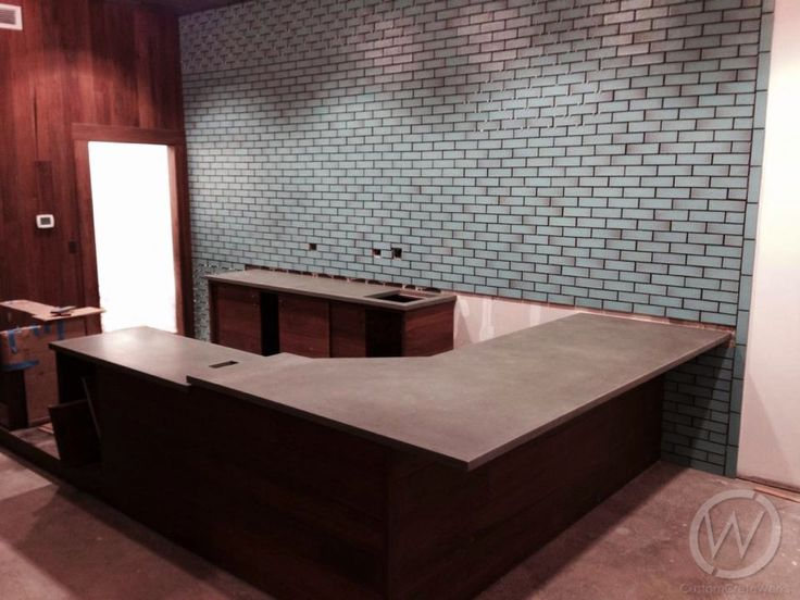 A welcoming #reception space that features concrete countertops or a concrete reception #desk is sure to impress every person who visits. Concrete is an ideal material for use in commercial spaces and instantly makes a grand statement.