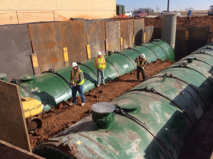 Backfilling the tanks about 23 with select backfill and