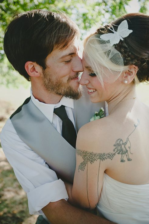 Make sure your wedding photos capture your best sides. | 13 Rad Ideas For A Tattoo-Inspired Wedding