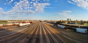 "4 picture panorama of the CP yard in Winnipeg taken by Carl Brownell/Joe-Lynn Design. Printed and stretched by Carl Brownell/Joe-Lynn Design. A great buy at $125.00 Firm Print is a 30"" x 14"" Giclée on Epson Exhibition Canvas Matte. Ready to hang. Our prints are sold by square inch so we have a print for everyone's budget. Call 204-586-4738 Find more images at www.joe-lynn.com/ We do custom matting and framing as well as Giclée fine art and canvas prints."