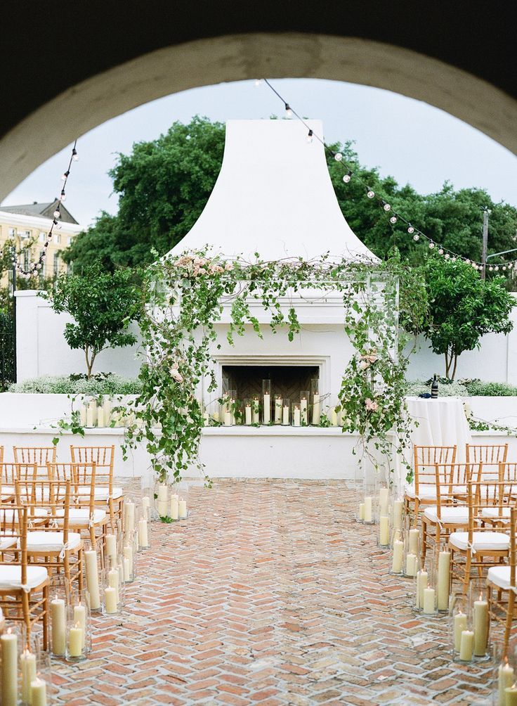 Lucite wedding pergola covered in florals.  Stunning outdoor fireplace with clear votives. Sapphire Events | Il Mercato | New Orleans Wedding | White and Green Wedding | Jewish Wedding Inspiration | Chuppah Inspiration
