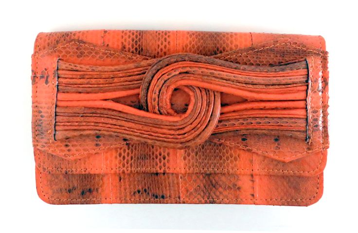 Bright orange watersnake leather clutch in our newest SUKI clutch/shoulder bag.  Wear in 3 ways - clutch (hand can go through knot), add strap for long shoulder, loop it over for short shoulder. #versatileclutch http://www.cheetlondon.com