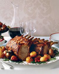 Citrus-Marinated Pork Rib Roast Recipe from Food & Wine...Perfect Christmas Roast:Chef Fabio Trabocchi infuses this pork roast with flavor by stuffing garlic cloves into the fatty side of the roast and marinating the meat with fresh herbs and citrus.