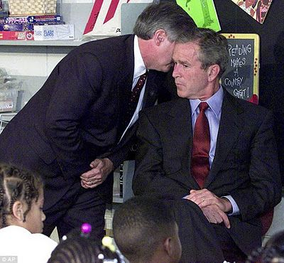 The moment when George W. Bush was told about the 9/11 attack on the Twin Towers.