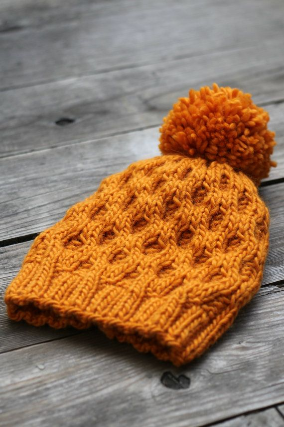 Knitting pattern, knitting tutorial for knit hat in honeycomb pattern. This knitted hat is really cozy, warm and stylish! It is perfect for fall and winter. And now you can make one by yourself! The pattern is easy and the result is really good looking :)  You will need:  - 100g of Heavy Worsted yarn (about 100g/140yds)  - US 7 straight needles  - US 10 straight needles  - Cable needle  - US 6 hook (optional)  - Pom-Pom Maker (optional)  Please note: This is a downloadable PDF-file, not the…
