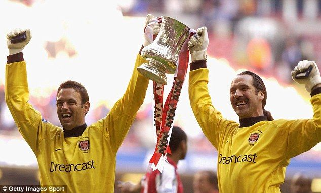 Richard Wright (left) holds up the FA Cup with the man he was signed to replace, David Sea...