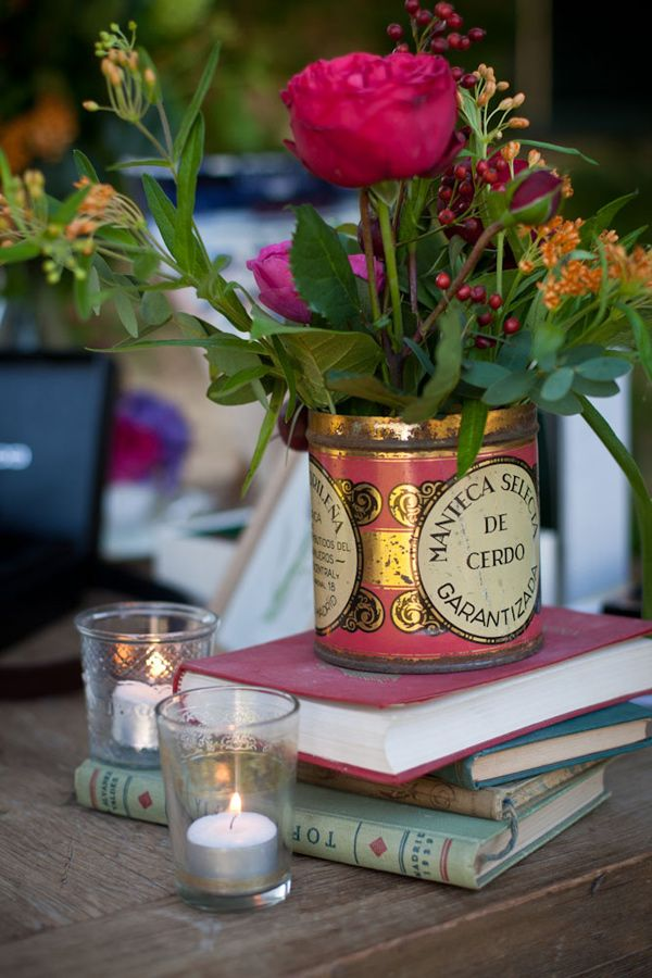 madrid bohemian wedding. vintage books + lard tin = pretty tablescape I'd have to substitute the lard tin above for a tea tin. It sure is a nice way to use books and tea things that you love.
