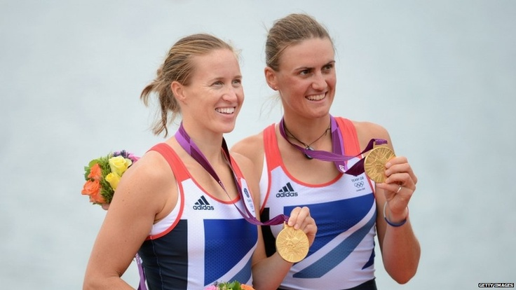 Helen Glover and Heather Stanning with their gold medals, the first won by Team GB at the Games