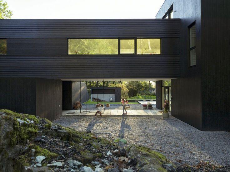 Bent Rene Synnevag, Villa S, Saunders Architecture, частные дома в Норвегии, дом на сваях, парящий дом, светлый интерьер дома, черный фасад дома фото