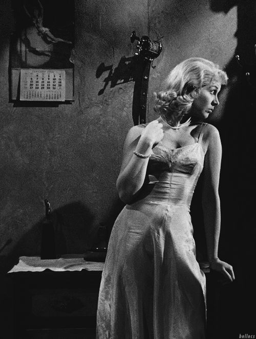 """Vivien Leigh as Blanche DuBois in a film representation of Tennessee Williams' """"A Streetcar Named Desire."""" After going to stay with her sister during troubling times. During her stay the truth about these troubling times and her endeavors comes out, and her mental state declines rapidly ending in Blanche going to an asylum. Blanche is a young stereotypical upper class southern belle type, and tries to stick to that while not letting the truth about her get out."""